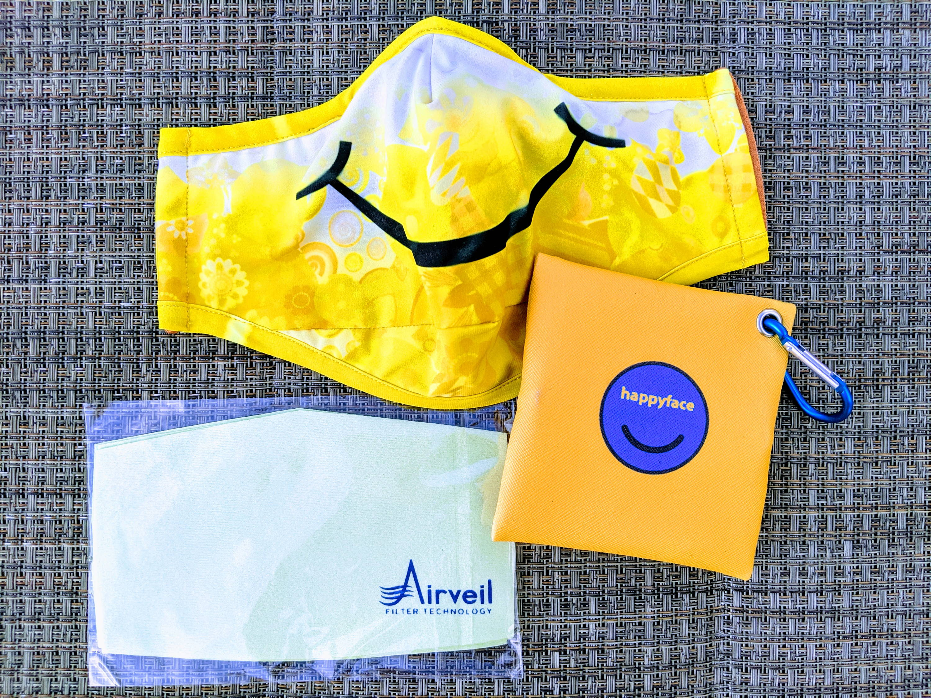 yellow smiley face Happyface mask with zippered carrying pouch and Airveil nanofiber filter inserts