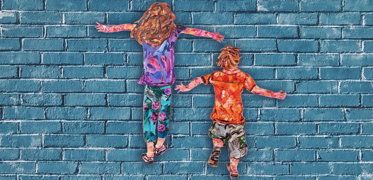 Children collages against blue brick wall