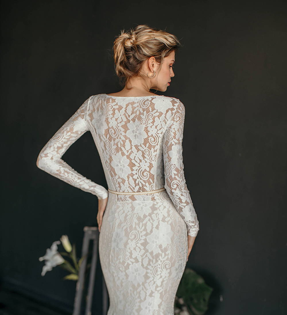 This long sleeve lace mermaid wedding dress is the perfect vintage style wedding gown.
