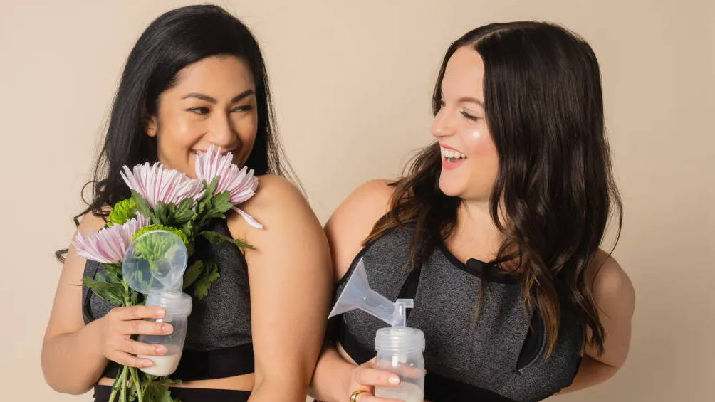 lilu moms wearing lilu massage bra to pump milk more easily, holding flowers and smiling
