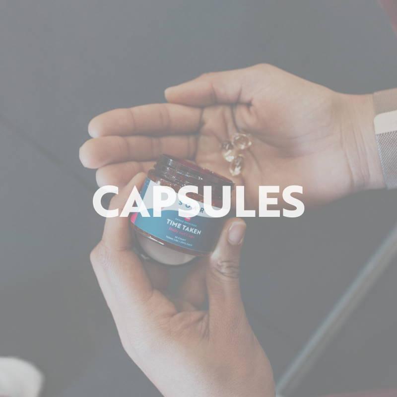 Person holding SOAR™ CBD hemp capsules