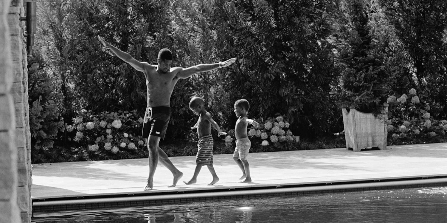 Usher with his sons at the pool