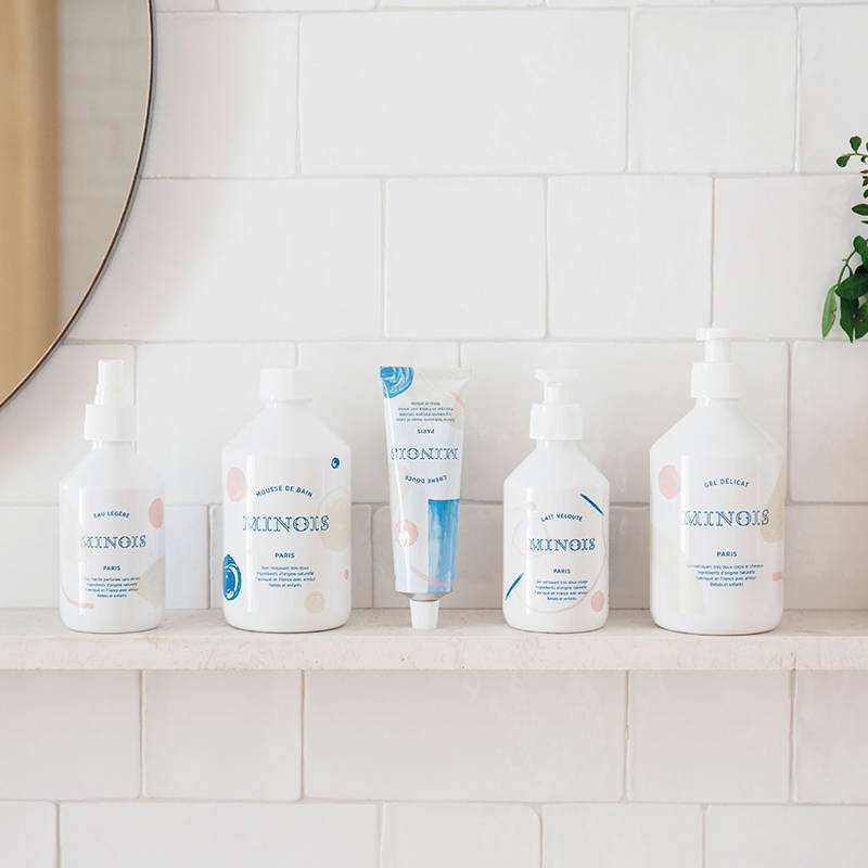 A styled photograph of the Minois collection, a skincare brand sold at The Hambledon, which is safe for all ages