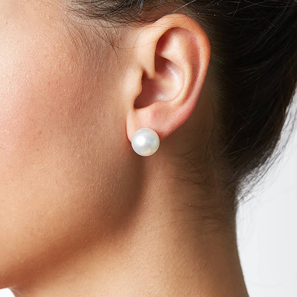 11-12mm pearl stud earrings on a model