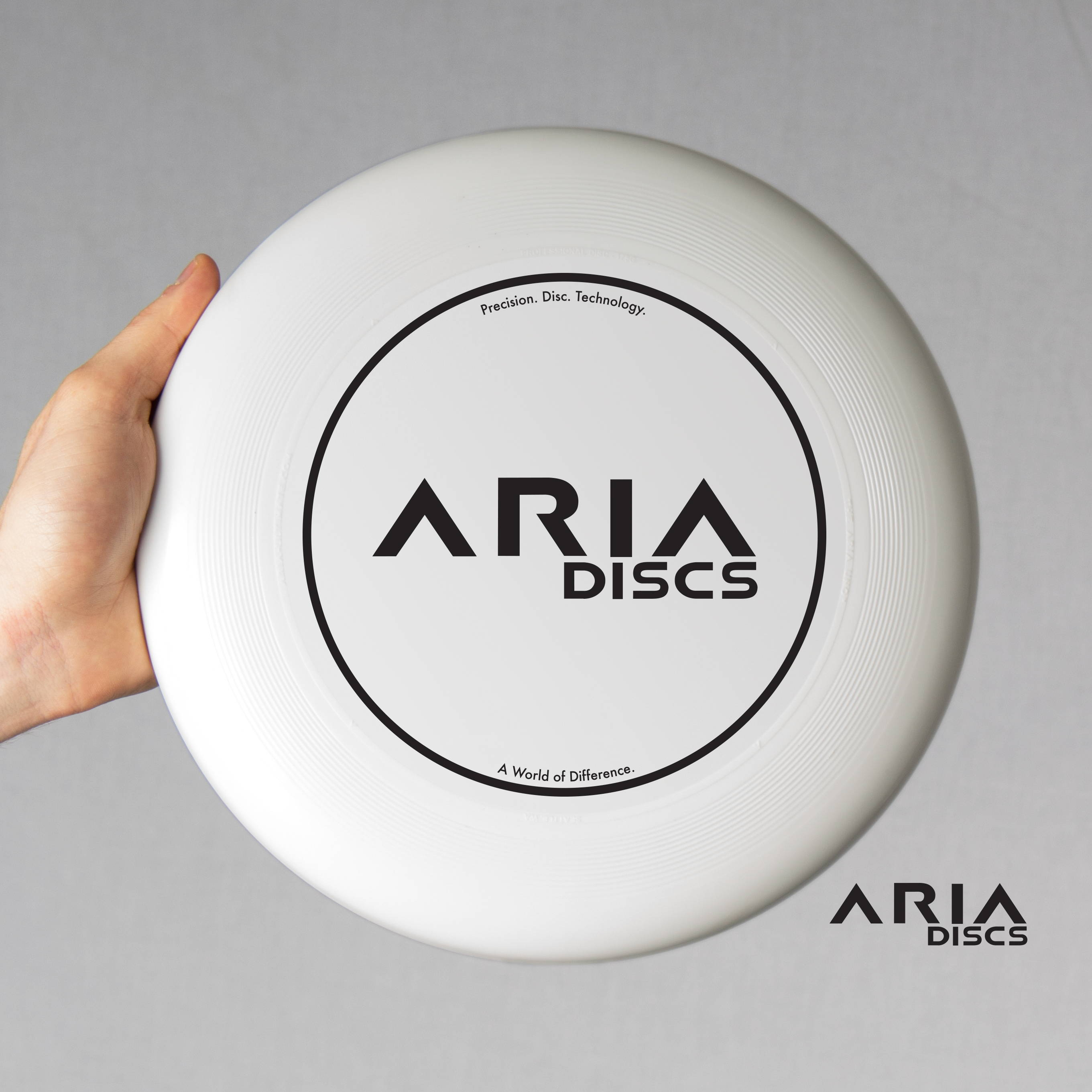 ARIA professional official ultimate flying disc for the sport commonly known as 'ultimate frisbee' original aria logo disc design