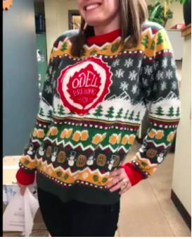 Woman wearing Odell Christmas Sweater
