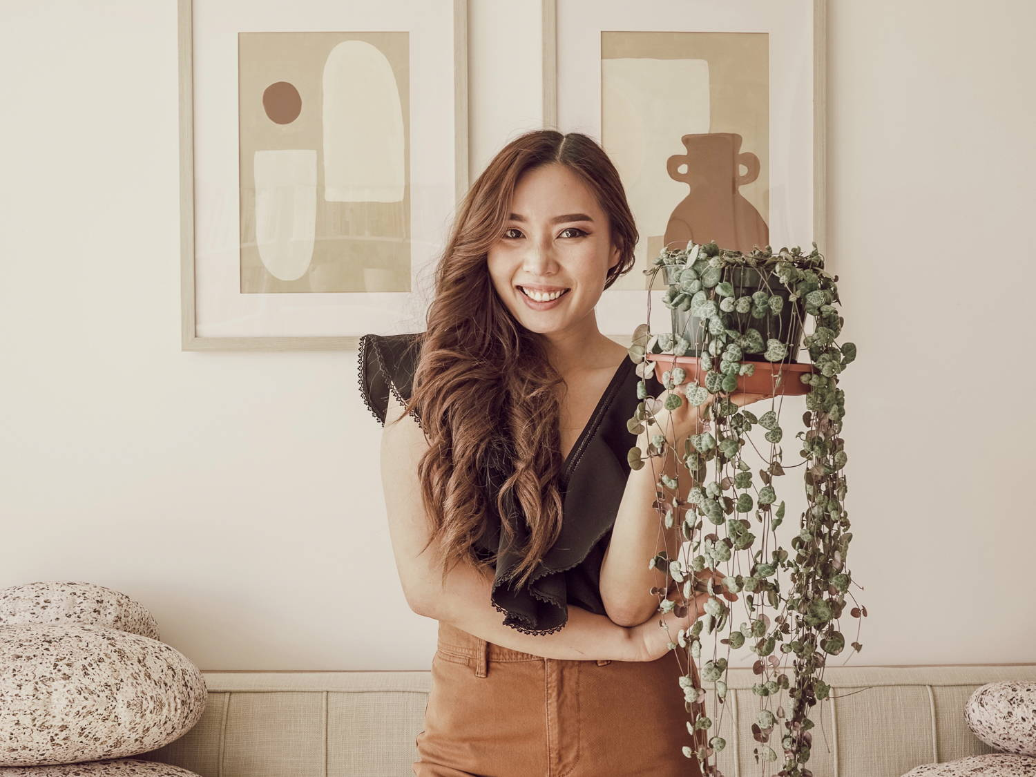 Picture of Anh Lin holding a pot with plant