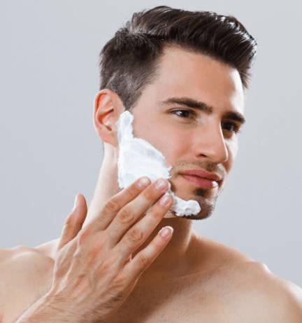 Hygienic Guy Applying Shaving Cream