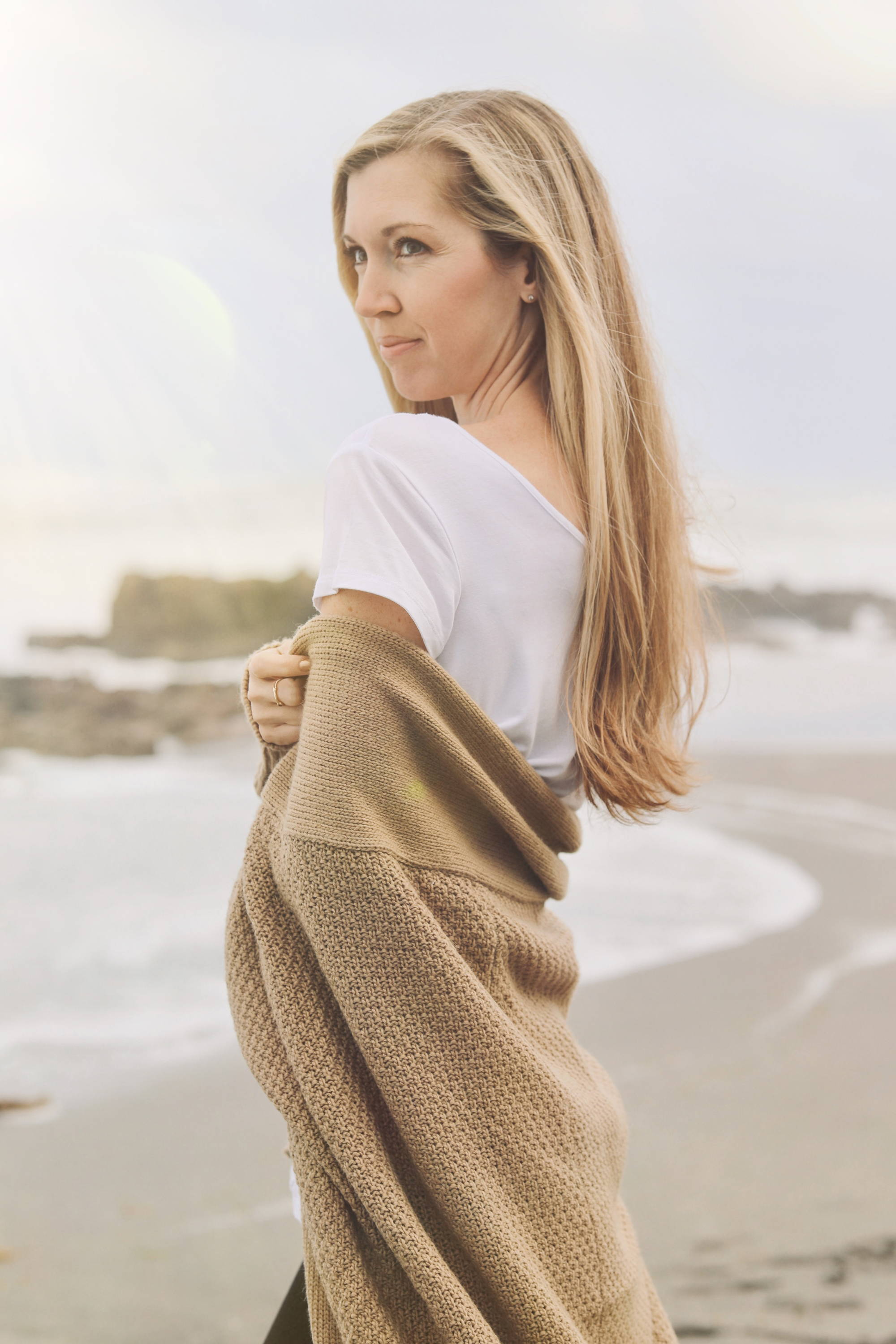 Model wearing the Zeville Cardigan on camel on the beach