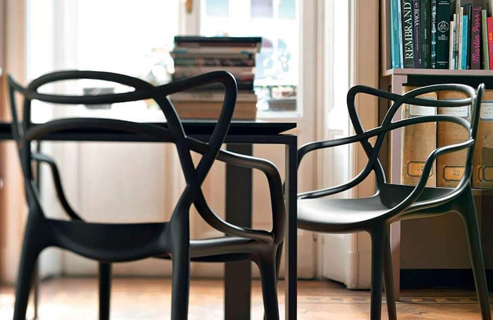 Decorating with black furniture is on trend, and here's why we love it.