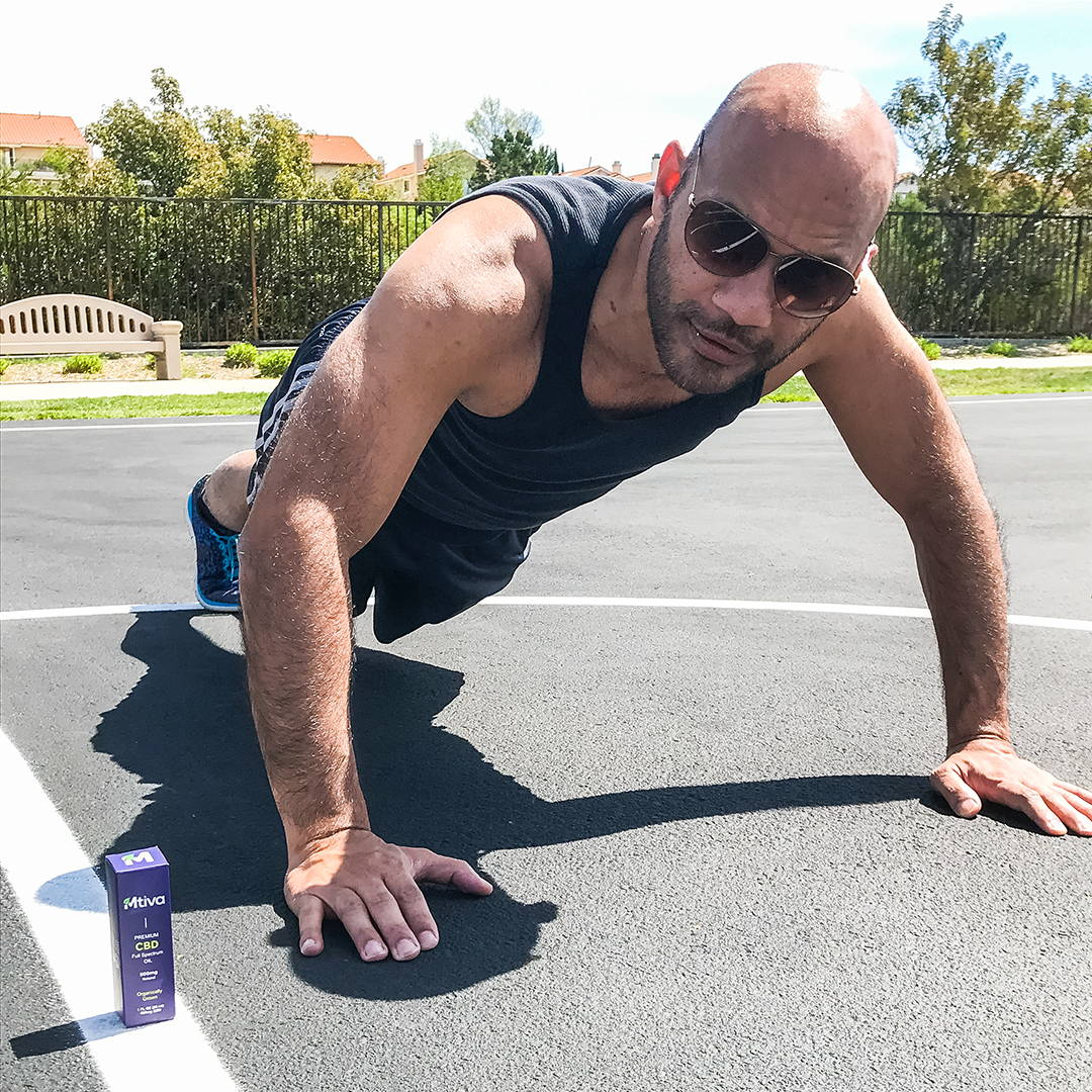 A customer enjoying a workout in the park on a nice day with our CBD Oil.