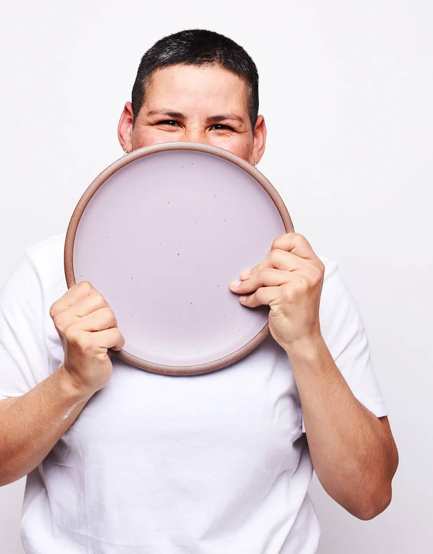 Karla holding an East Fork Dinner Plate in Taro