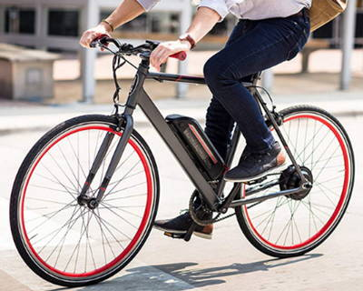 An electric road bike commuting around town.