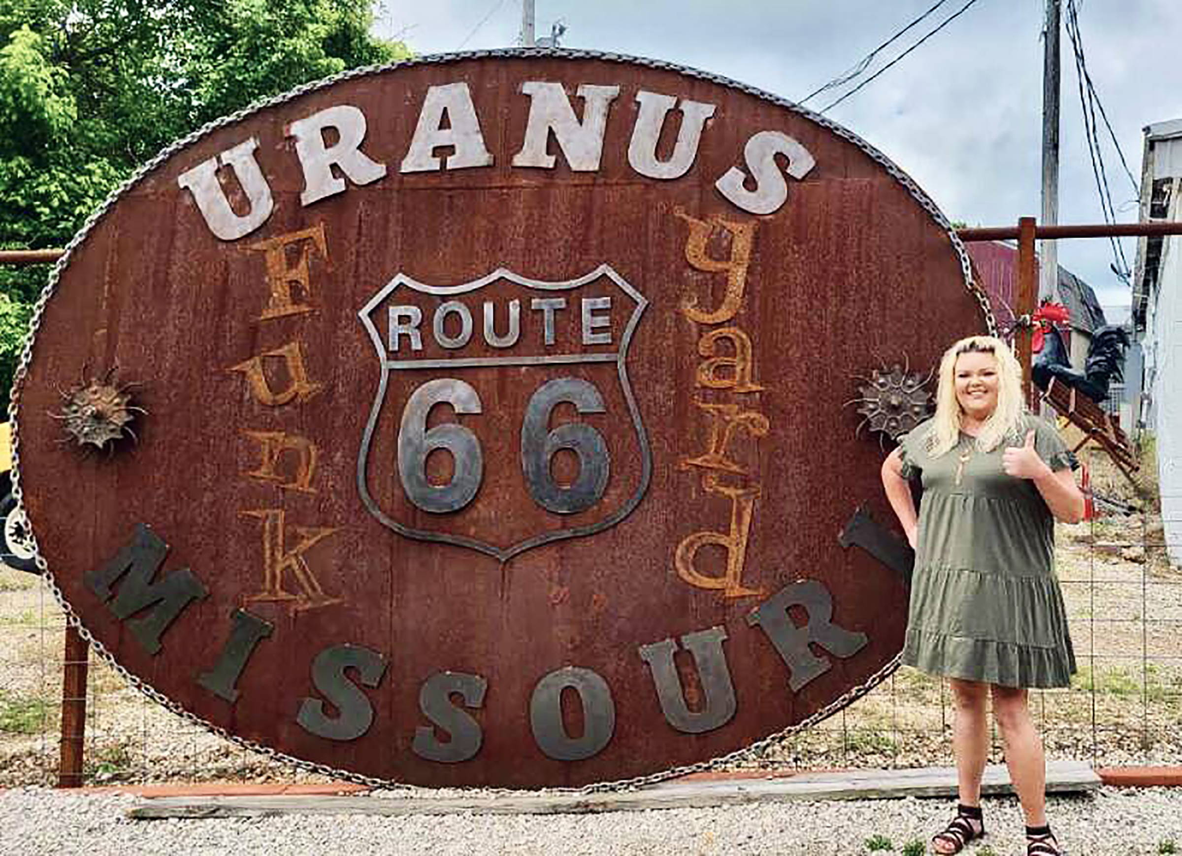 Miss Tiffany next to the World's Largest Belt Buckle in Uranus.