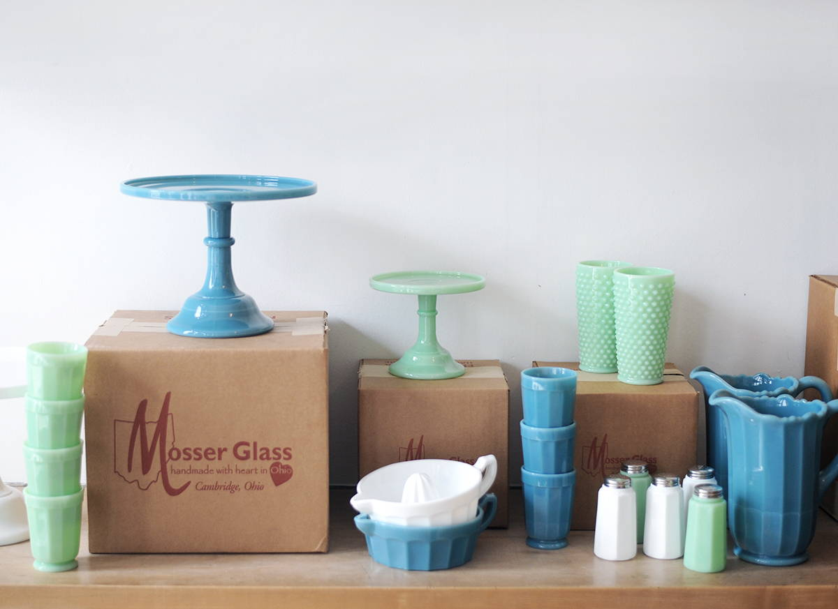A photograph of Mosser piled up on Mosser branded boxes.