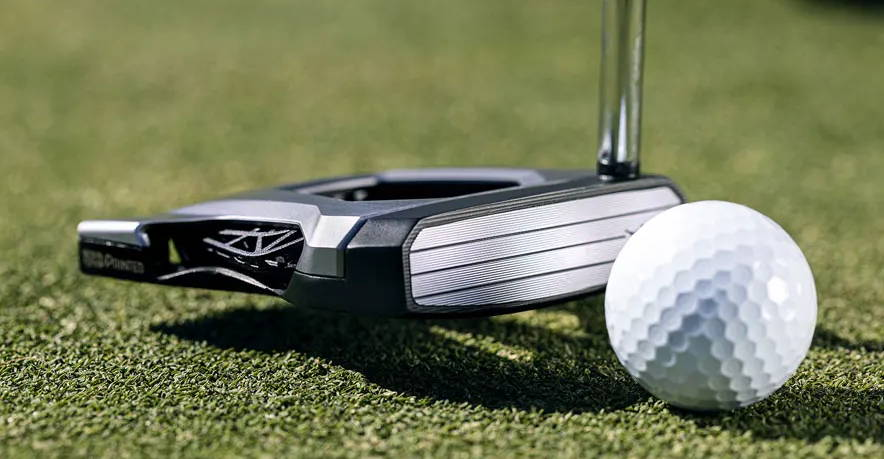 Closeup of COBRA KING Agera 3D Printed putter with golf ball on the green