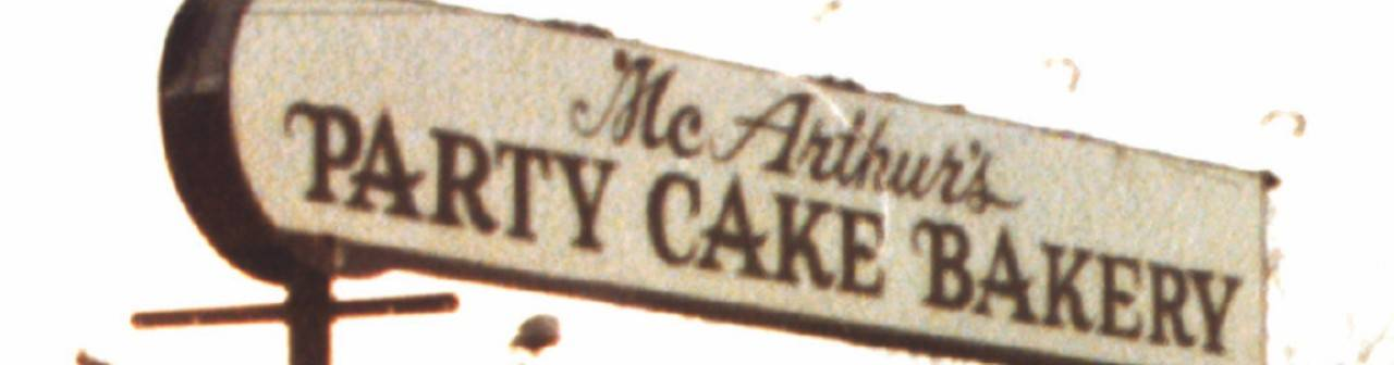 A historical sign for McArthur's Bakery in St. Louis that was called McArthur's Party Cake Bakery.