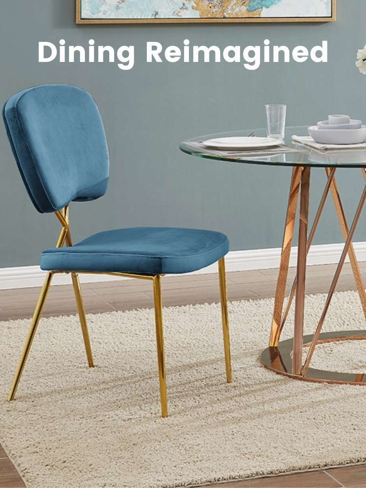 A dining area with a blue Iconic Home dining chair by a table