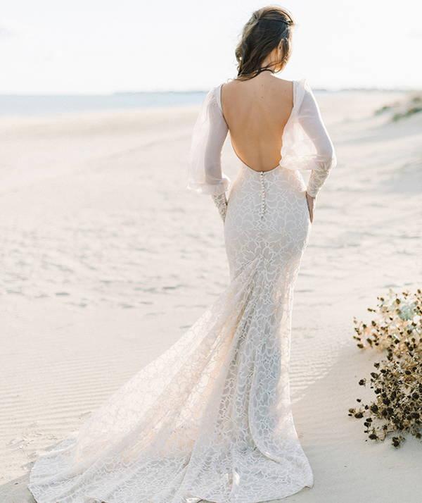 Affordable wedding dresses at She Wore Flowers. Shop mermaid or trumpet wedding dress shape.