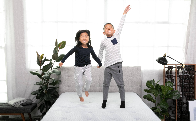 Kids jumping on Helix mattress