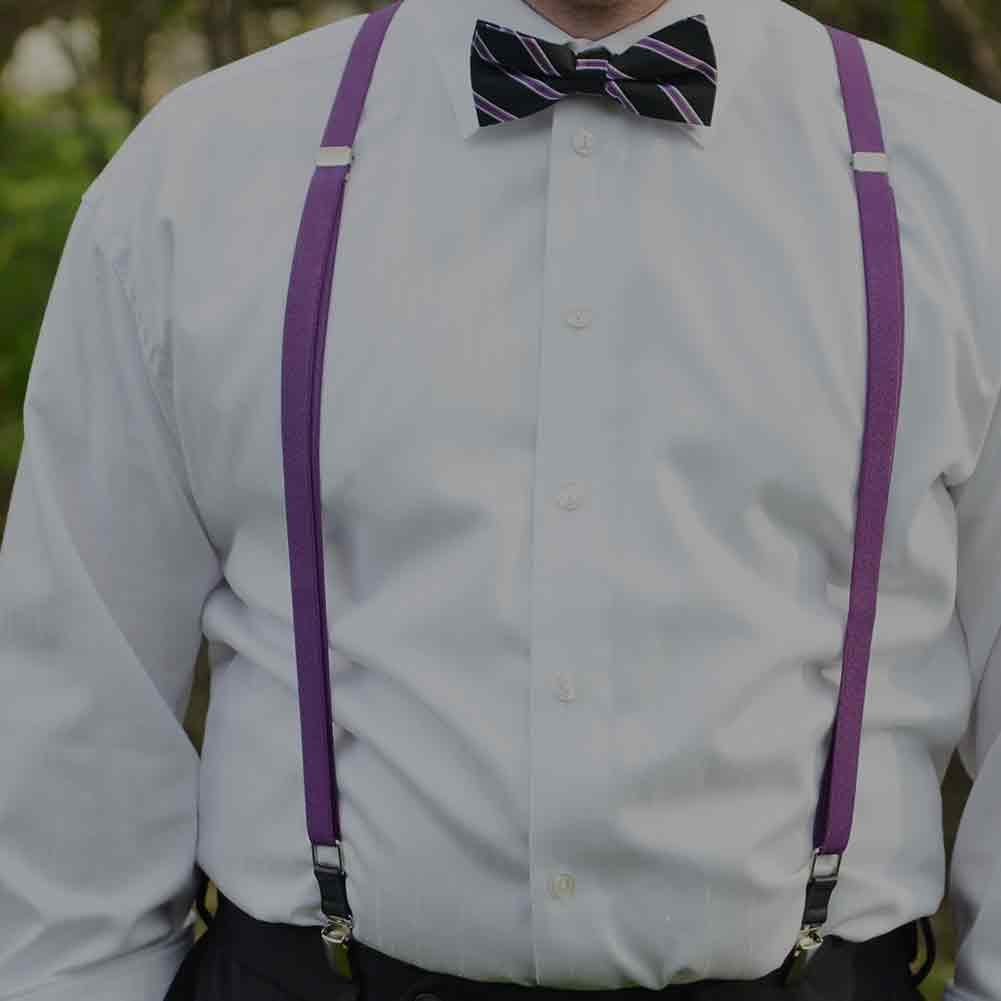 Man wearing purple suspenders and a black and purple striped bow tie