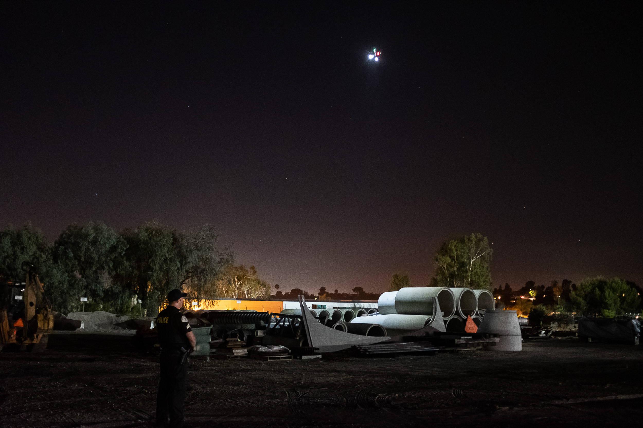 Matrice with FoxFury Rugo lights illuminates construction equipment on the ground.