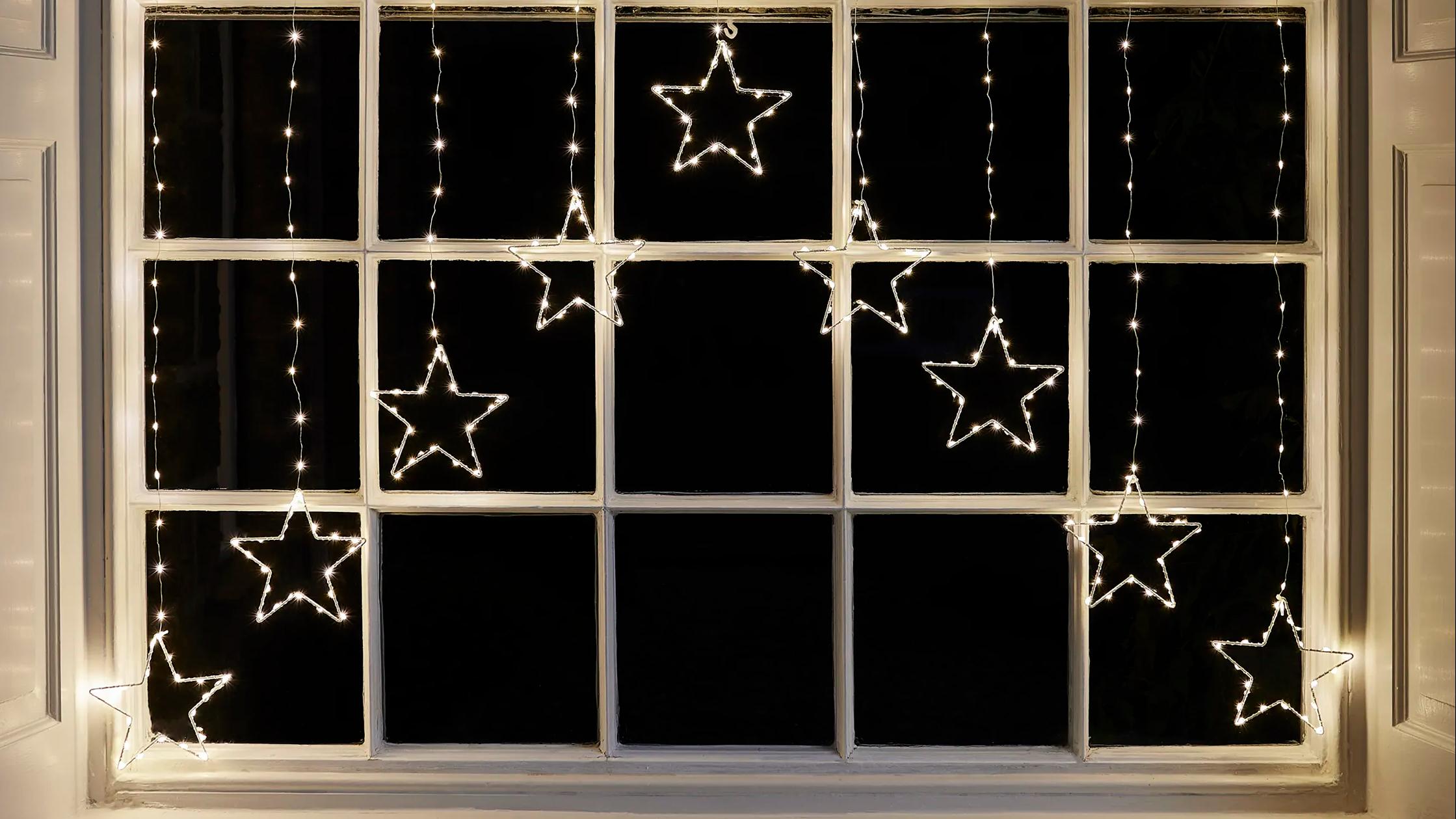 Osby star curtain light illuminated in window
