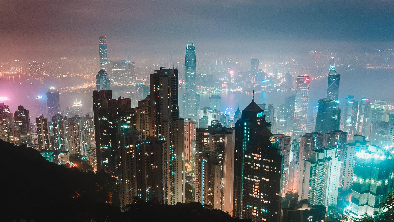 Hong Kong skyline at night through a blue haze