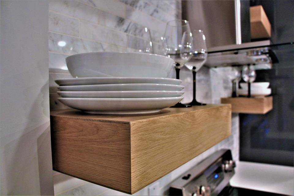 Floating kitchen shelves made with Naked hardwood flooring planks