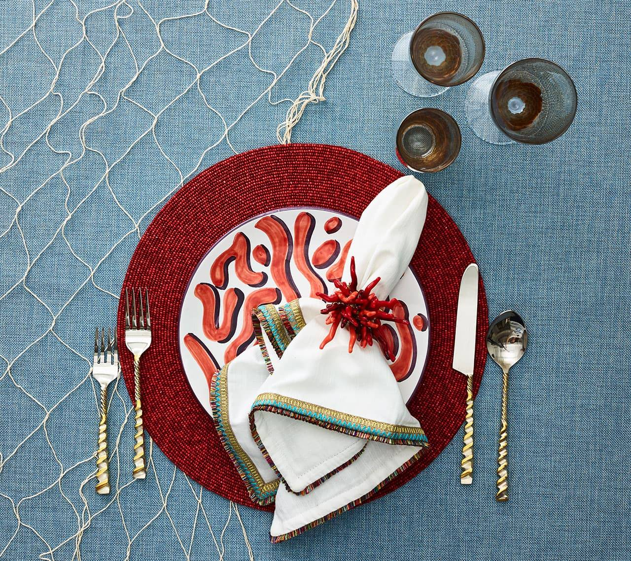 dark red placemat with white napkin
