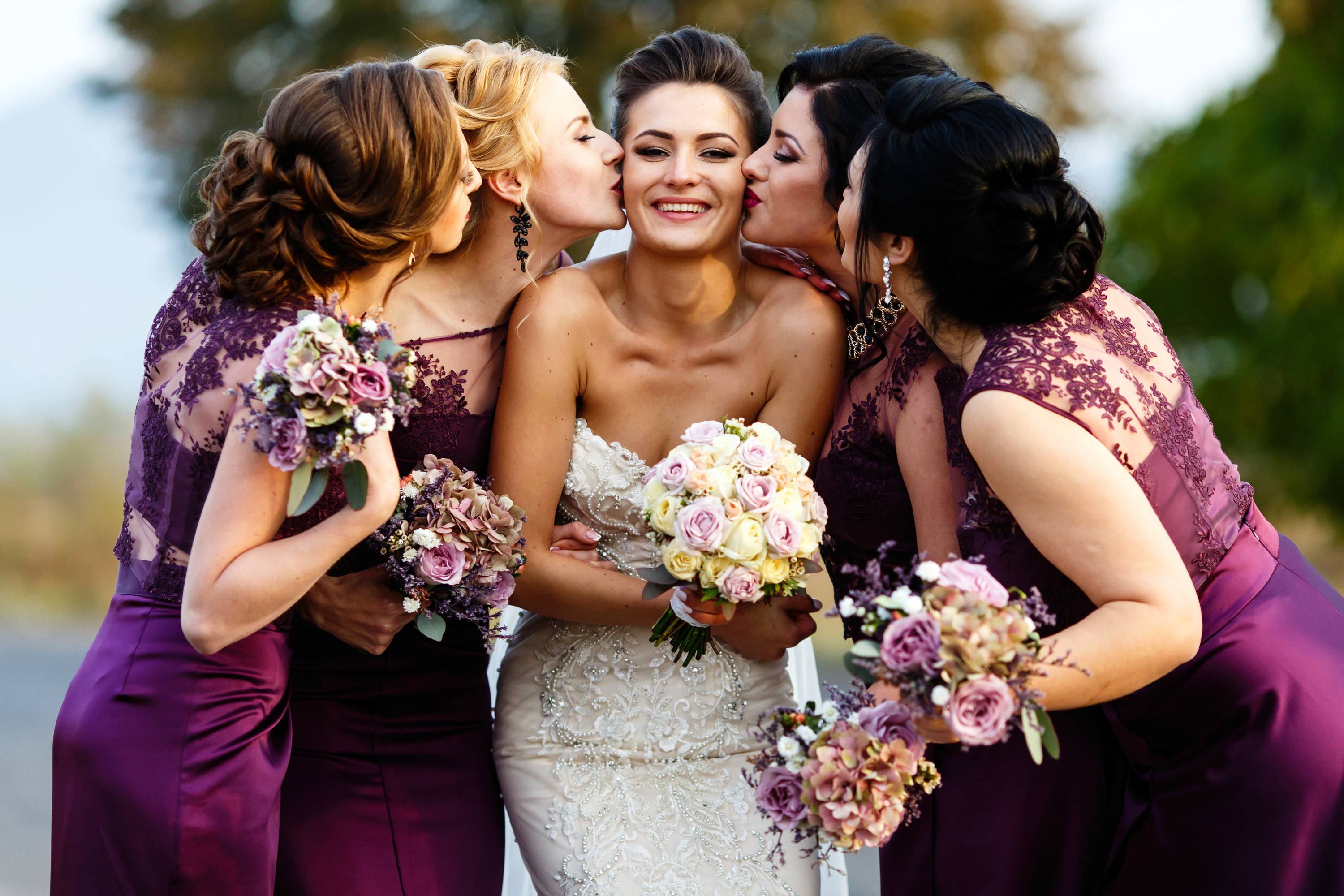 Bridesmaid kissing the bride