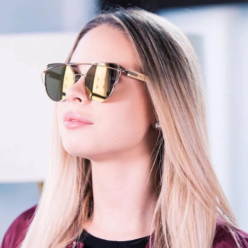 Woman wearing Kraywoods Golden Sun Kiss, Flashy Sunglasses made from Bamboo wood with 100% UV Protection Rose Gold Lenses