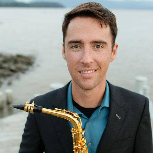 Stephen Page holding a saxophone