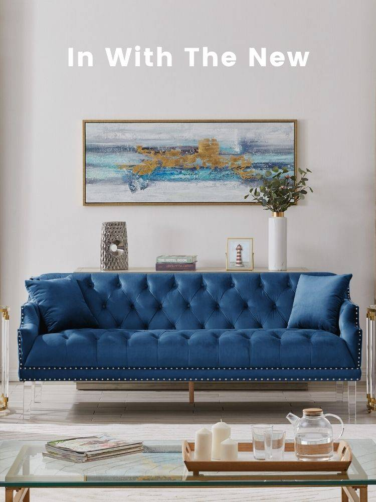 A living room with a navy blue Iconic Home Elsa velvet sofa in the middle