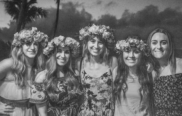 Beachwaver staff wear flower crowns at the welcome dinner at at the Beachwaver Maui Pro Women's Surf Championships
