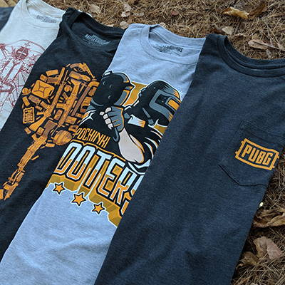 Photo showing a collection of PUBG shirts