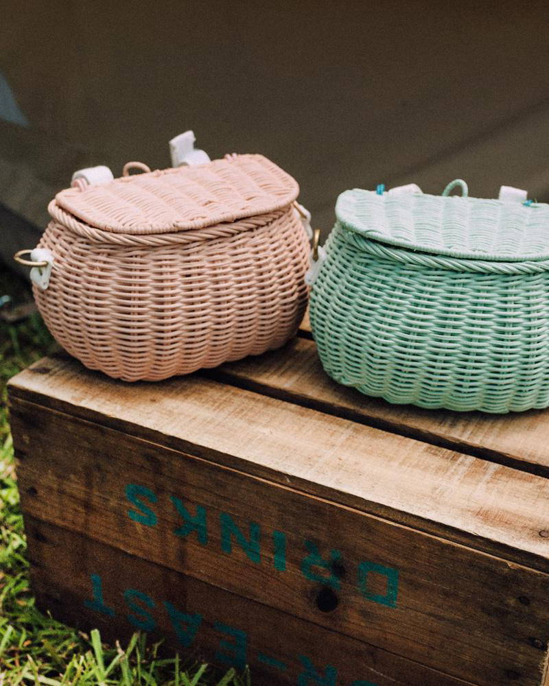 Olli Ella Chari Bags in Mint and Rose styled on a wooden box.