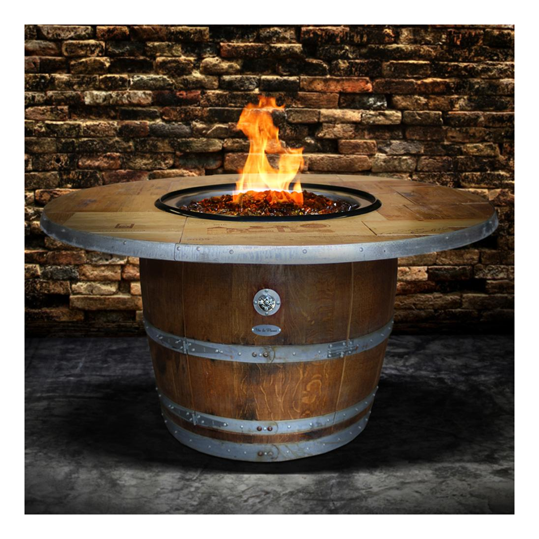 A wine barrel fire pit ignited and ready for guests