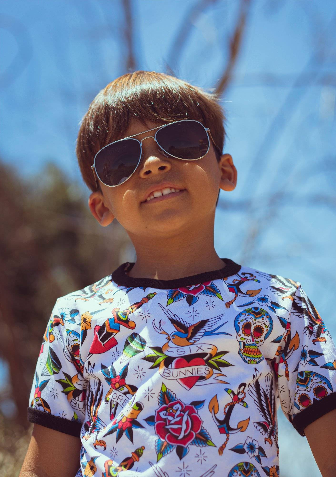 Young boy in sunglasses and graphic tee