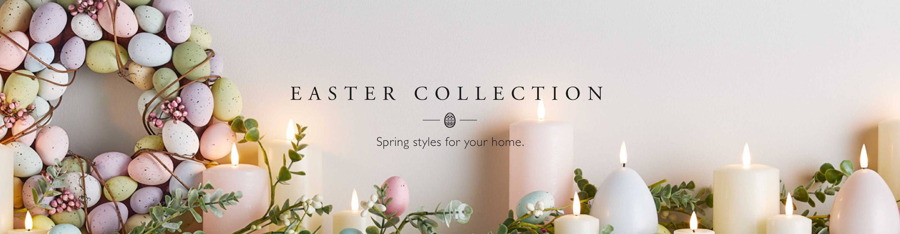 Easter mantel with pastel TruGlow candles and Easter garland and wreath