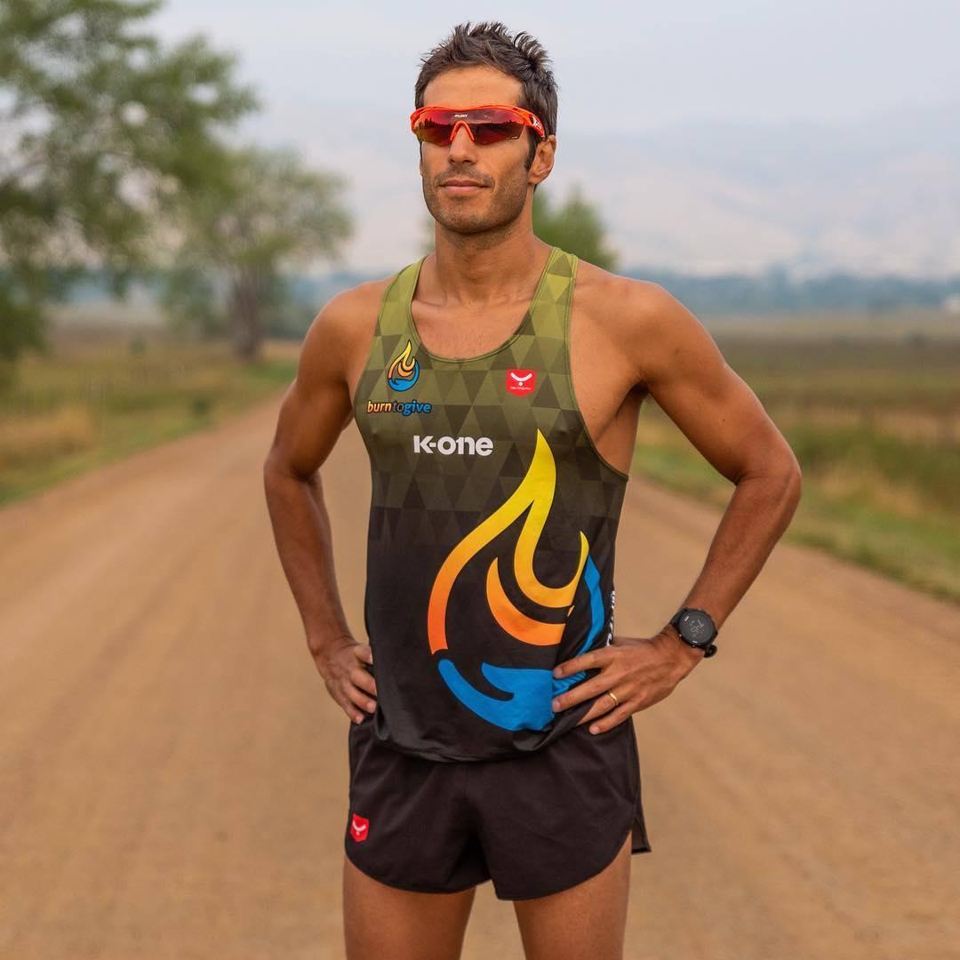Eduardo posed on gravel road during a run
