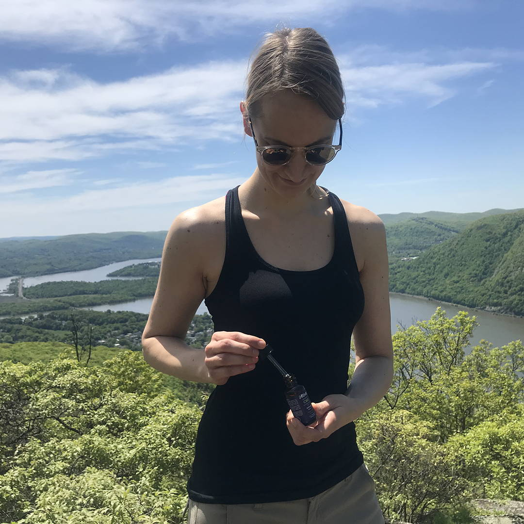 After a long hike a customer takes our CBD Oil to help with body aches.