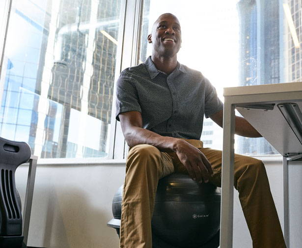 Businessman using the Ultimate Balance Ball Chair in an office
