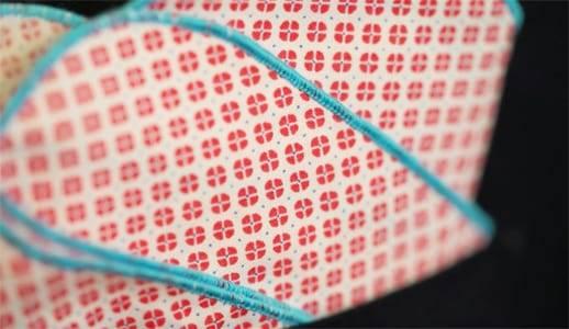 Folded cotton poppy print pocket square in jacket breast pocket