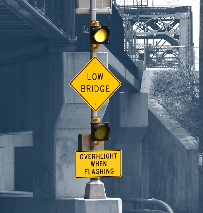 Low-bridge-oveheight-warning-sign