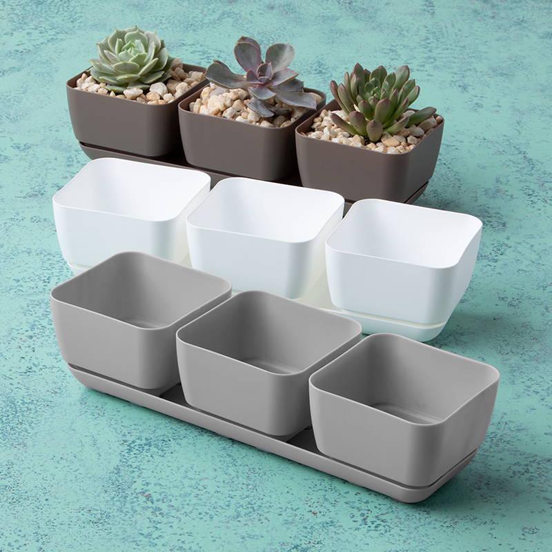 A taupe, a white, and a gray trio planter