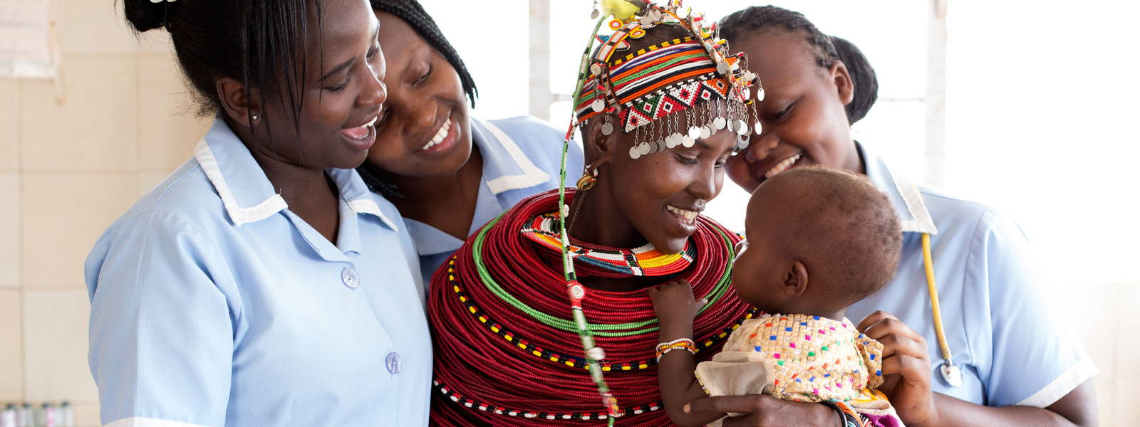 Nurses with mother and baby in Kenya, Africa