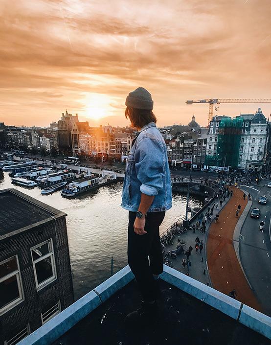 man on roof overlooking harbor