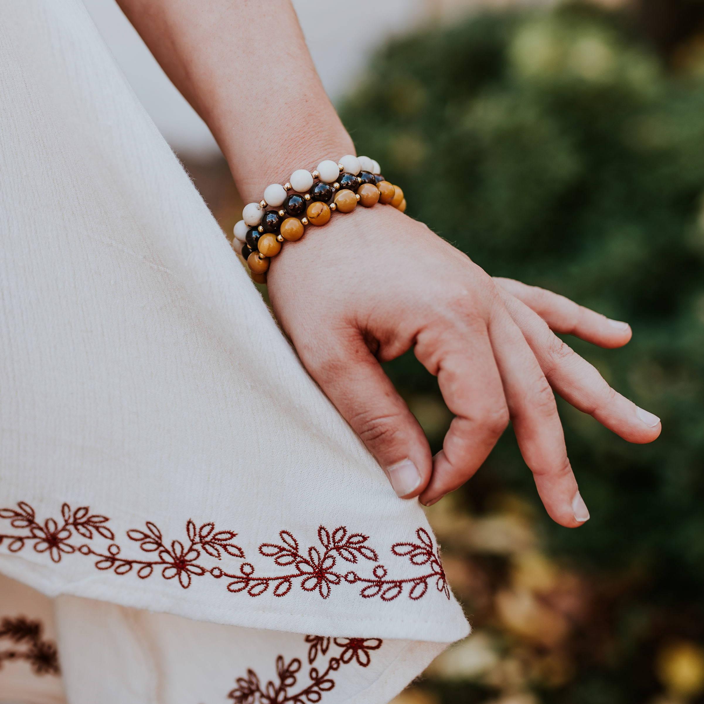 bracelets on wrist holding skirt