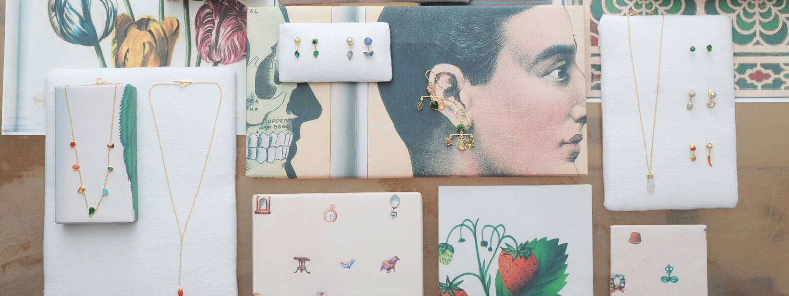 Our display of Grainne Morton Jewellery laid out on images form teh John Derian Picture Book.